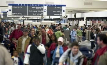 Travelers work their way through Atlanta's Hartsfield-Jackson International Airport in GA, where Louis Lu Yu had been deported by federal authorities on a plane bound for Seoul with a connection to Shanghai.  (Barry Williams/Getty Images)