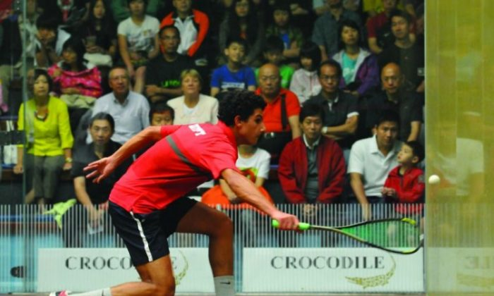 Catching eyes with a classy comeback ... Egyptian teenager Mazen Hesham Ga Sabry's rousing win against Max Lee after Hong Kong's No. 1 player won the first two games in the 8th annual Crocodile Squash Challenge Cup 2012 in Hong Kong on Sunday Sept. 2. (Bill Cox/Epoch Times Staff)