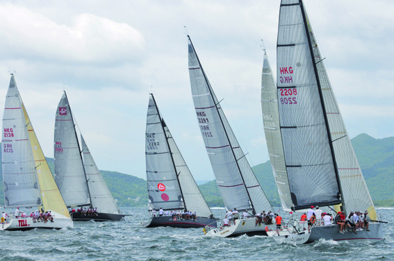 (L to R) 'Stella', 'Freefire', 'EFG Mandrake', 'Electra', 'Sell Side Dream' and 'Ambush' at a Division A and B race start during the Hebe Haven Yacht Club's Nautica Typhoon Series 2012. (Bill Cox/The Epoch Times)
