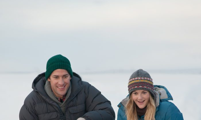 "John Krasinski and Drew Barrymore in the adventure ""Big Miracle,"" greeting one of the trapped California gray whales. (Darren Michaels/ Universal Studios)"