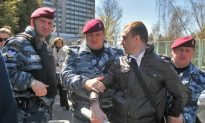 Police Interfere with Protest Against Chinese Official in Ukraine