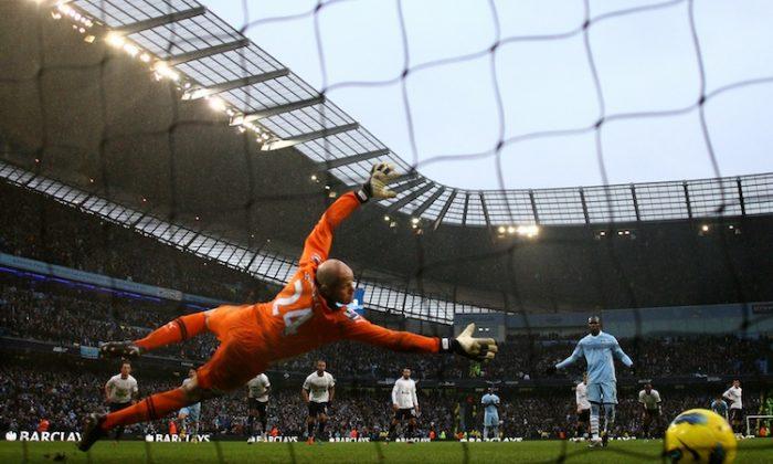 Tottenham's Gareth Bale celebrates his equalizing goal against Manchester City on Sunday. (Paul Ellis/AFP/Getty Images)