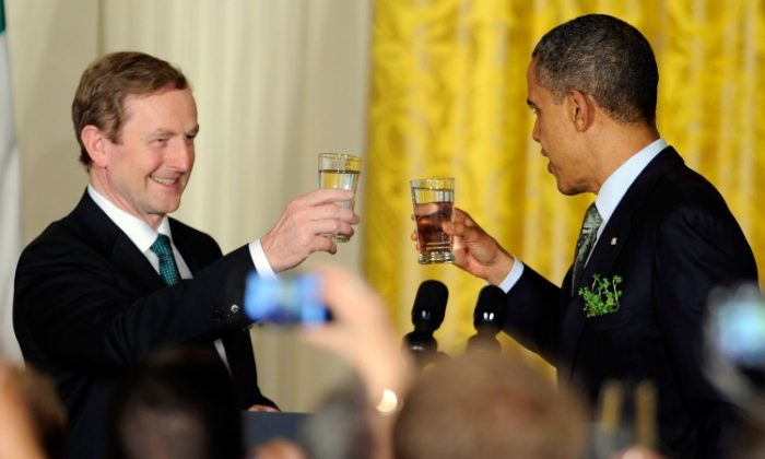 CHEERS! US President Barack Obama (R) toasts with Irish Prime Minister Enda Kenny during a reception in the East Room of the White House on March 20th, 2012 in Washington, D.C. (Mike Theiler-Pool/Getty Images)