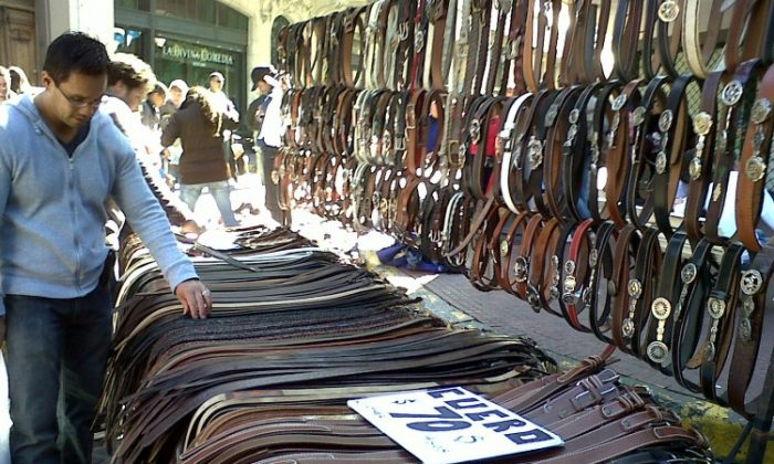 A street vendor displays his belts at the San Telmo market in Buenos Aires. (Michele Goncalves/ The Epoch Times)