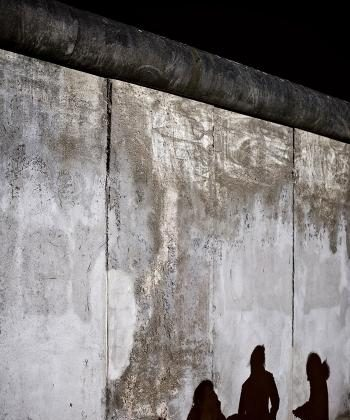 The shadows from a group of tourists are cast onto an original section of the Berlin Wall in Bernauer Strasse, central Berlin, on Nov. 8.  (Leon Neal/AFP/Getty Images)