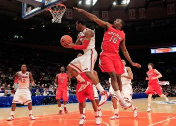 BIG EAST TOURNAMENT: Paris Horne of the St. John's Red Storm is challenged by Rutgers' James Beatty in second round action at Madison Square Garden on Wednesday. (Chris Trotman/Getty Images)