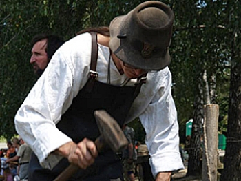 UKRAINE: A blacksmith makes a horseshoe at the annual Day of Blacksmiths festival. (Hannah Varavva/NTDTV)