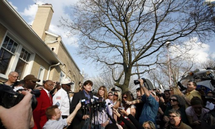 Former Illinois Gov. Rod Blagojevich (L) speaks at a news conference outside his home while wife Patti (R) looks on, March 14 in Chicago. Blagojevich must report to a federal prison in Colorado by tomorrow, to start serving a 14-year term he received for his conviction on numerous counts of fraud and corruption, including attempting to sell the vacant U.S. Senate seat held by then Sen. Barack Obama. (Frank Polich/Getty Images)