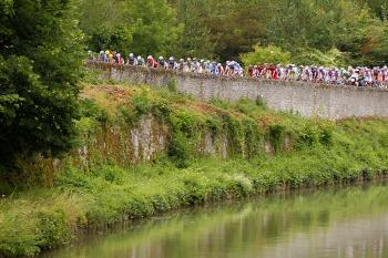 The peloton crosses a bridge on July 9, 2010 at the start of Stage six of the 2010 Tour de France. (Joel Saget/AFP/Getty Images)