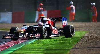Sebastien Buemi goes wide at Degner corner during qualifying for the Japanese Formula One Grand Prix. (Vladimir Rys/Bongarts/Getty Images)