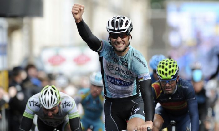 Tom Boonen (C) celebrates as he wins Stage Two of the 2012 Paris-Nice cycling race. (Pascal Pavani/AFP/Getty Images)