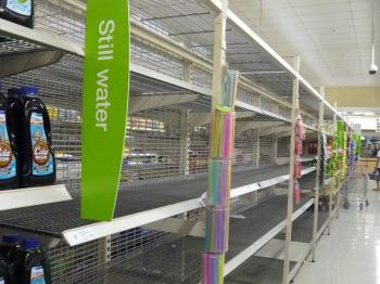 Queensland floods: Brisbane residents stock up on essentials prior to the peak floods, including bread and bottled water, leaving the shelves bare in local shops. (Louise Stevanovic/The Epoch Times)