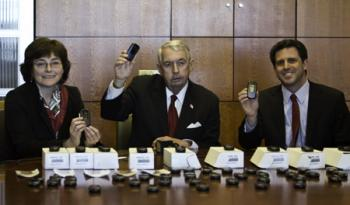 PHONES FOR VICTIMS: (L to R) Wanda Lucibello, District Attorney Charles Hynes, and David Samberg. (Phoebe Zheng/The Epoch Times)