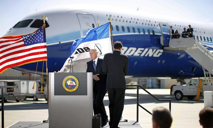 California Gov. Jerry Brown steps to the podium to speak at a presentation of the new Boeing 787 Dreamliner passenger jet, March 14 in Long Beach, Calif. (David McNew/Getty Images)
