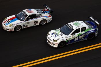 The #59 Brumos Racing Porsche GT3 Cup driven by Marc Leib passes the #36 Yellow Dragon Motorsports Mazda RX-8 driven by Mikel Miller during the Rolex 24. (Chris Graythen/Getty Images)