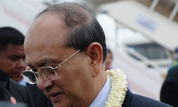 Burma's president Thein Sein gets in a limousine after arriving at Pochentong airport in Phnom Penh on April 2, to attend the 20th Association Southeast Asian Nations (ASEAN ) summit that took place in the Cambodian capital. (Hoang Dinh Nam/AFP/Getty Images)