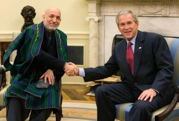 OVAL OFFICE: President George W. Bush (R) shakes hands with Afghan President Hamid Karzai (L) during their meeting in the Oval Office of the White House Sept. 26 in Washington, DC. (Alex Wong/Getty Images)