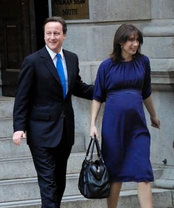 David Cameron heads out of Conservative Party headquarters with his pregnant wife Samantha on his way to the Queen at Buckingham palace. The Queen formally asked him to form the next government as prime minister. (Edward Stephen/Epoch Times)