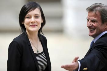 RETURNED HOME: French academic Clotilde Reiss (L) and French Foreign Affairs Minister Bernard Kouchner leave the Elysee Palace in Paris, after being received by French President Nicolas Sarkozy after her return from Teheran, on May 16.  (Lionel Bonaventure/Getty Images )