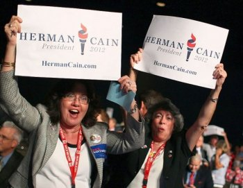 Herman Cain supporters Adelaida Rosario (L), and Mercedes Sabina (R) react to the announcement of Republican presidential candidate Herman Cain winning Florida's straw poll at the Florida Presidency 5 convention at the Orange County Convention Center, Sept. 24, in Orlando, Fla. Herman Cain won Florida's straw poll with 37.11 percent of the vote. (Mark Wilson/Getty Images)