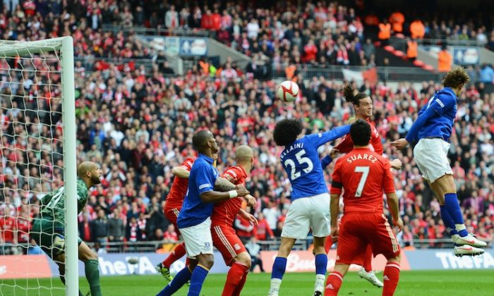 Liverpool's Andy Carroll rises above the crowd to head home the game-winning goal against Everton in the FA Cup semifinal (Mike Hewitt/Getty Images)
