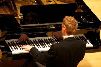 AT THE KEYBOARD: A bird's eye view of Carter Larsen at the piano. (Kwiri Yang )