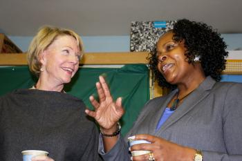TO THE PRINCIPAL'S OFFICE: Cathie Black (L) mingles with educators and parents, including the principal of PS 626, Joletha Ferguson (R). (Tara MacIsaac/ The Epoch Times)