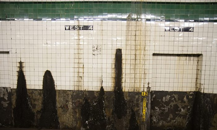 "The 4th Ave Subway platform shown with a hole in the wall is located in the Lower East Side of Manhattan. According to the Straphangers' State of the Station Platforms survey the 4th Ave platform was given the ""Ugly Category."" (Benjamin Chasteen/The Epoch Times)"