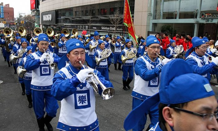 The Divine Land Marching Band participates in the 2012 Chinese New Year parade in Flushing, New York, on Saturday. (Ben Chasteen/The Epoch Times)