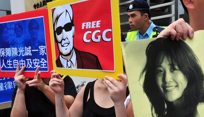 Activists hold banners in support of blind Chinese activist Chen Guangcheng and human rights activist He Peirong, who helped drive Chen on April 22 from his home in Dongshigu village, to a safe location in another province, during a protest in Hong Kong on May 4. (Laurent Fievet/AFP/GettyImages)