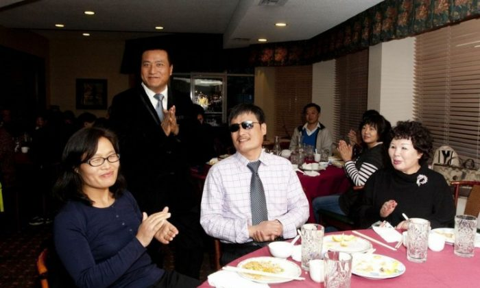 Chen Guangcheng (center) enjoyed a meal with members of the local Chinese community at a restaurant in Novato, California, on March 16. After receiving an award for his work, he highlighted what he called the gangster-like nature of the Chinese Communist Party. (Alex Ma/The Epoch Times)