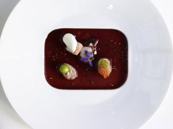 CHERRY CONSOMME:  Created by pasty chef Marc Aumon, it is like jewels in a pond of wine. (Ellen Silverman)