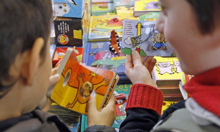 Children reading. (Francois Guillot/Getty Images)