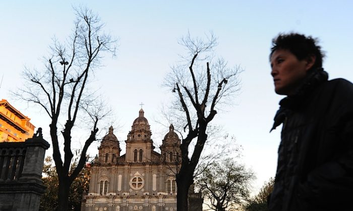 A man walks past the state-sanctioned St. Joseph's Catholic Cathedral on Wangfujing in Beijing. There are two Catholics churches in China: the officially sanctioned, Communist Party-controlled one, and an unofficial 'clandestine' Church that is loyal to the pope and the Vatican.(Frederic J. Brown/AFP/Getty Images)