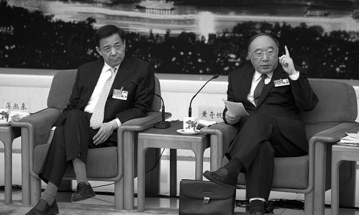 Bo Xilai (left) and Chongqing Mayor Huang Qifan (right) attending a meeting during the annual National People's Congress on March 6, 2011 in Beijing. Bo was removed from his post as Chongqing's Party chief on March 15, 2012. (Feng Li/Getty Images)