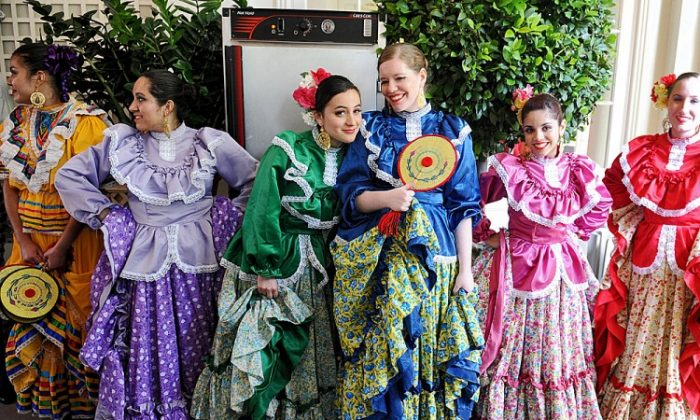 Dancers of the Ballet Folklorico Mexicano wait to perform during a Cinco de Mayo reception in the Rose Garden at the White House, May 3. Cinco de Mayo celebrates the Battle of Puebla between Mexico and France in 1862. (Olivier Douliery-Pool/Getty Images)