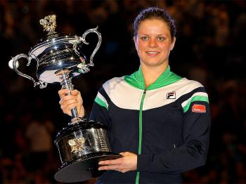 Kim Clijsters poses with the Daphne Akhurst Trophy after winning her women's final match against Li Na at the 2011 Australian Open. (Quinn Rooney/Getty Images)