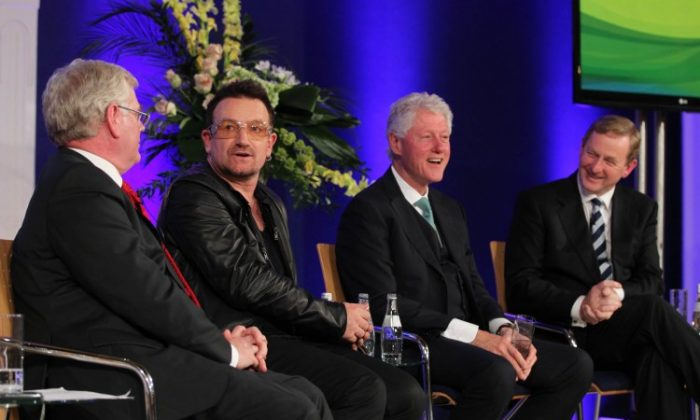 Global Irish Economic Forum Day 2 08.10.11, Pictured at the 2nd Day of the Global Irish Economic Forum at Dublin Castle. From left: An Tanaiste, Eamon Gilmore TD; Bono; former United States President Bill Clinton and An Taoiseach Enda Kenny TD (courtesy of Maxwell Photography)