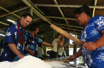 New Zealand Prime Minister John Key (L) visits a coconut plantation in Apia, Samoa, where coconut oil is produced. (Phil Walter/Getty Images)