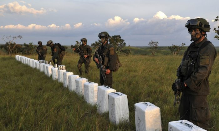 Colombian anti-narcotics police seize packages containing some 5 tons of cocaine from an illegal laboratory October 13, 2011. (Guillerm Legaria/AFP/Getty Images)
