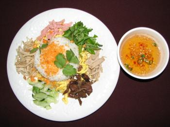 'HELL' RICE: The owners of the Saigon Cafe in Arlington, Virginia, dubbed this dish, 'Hell' Rice, also known in Vietnamese, as Com Am Phu, from the region of Hue, Vietnam. It's colorful rice dish with four kinds of pork. (Phuc Le)