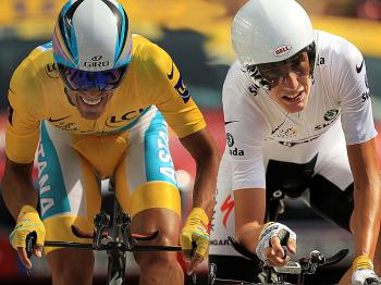 In this composite photo, Alberto Contador and Andy Schleck cross the finish line in Stage 19's individual time trial, deciding who will win the 2010 Tour de France. (Spencer Platt/Getty Images)