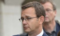 Bribery Charges for Two Murdoch Aides