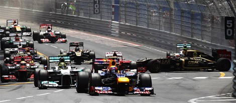 Mark Webber leads the field into the first corner while Roman Grosjean (R) spins in front of Michael Schumacher, before spinning back across the road, collecting several cars. (Mark Thompson/Getty Images)