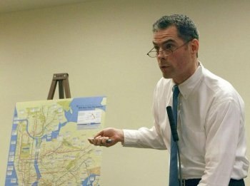 TALE OF TWO CITIES: Geoffrey Croft, president of New York City Park Advocates, called the distribution of Park Enforcement Patrol officers a 'tale of two cities,' as he went through different parks on the map and illustrated a disparate allotment of officers to each at a City Council hearing on Wednesday. (Tara MacIsaac/The Epoch Times)