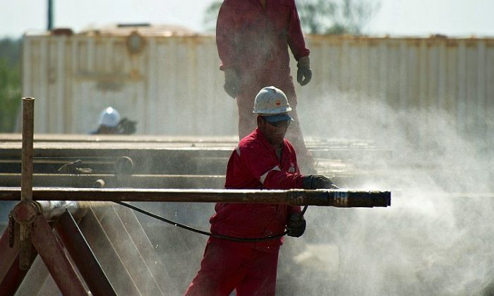 Employees work in an oil rig operated by Cuba and China, in eastern Havana in April. With Cuba's increased oil exploration and drilling in the Gulf, researchers in Florida are calling for contingency plans to be developed for coastal areas in case of an oil spill. (Adalberto Roque/AFP/Getty Images)