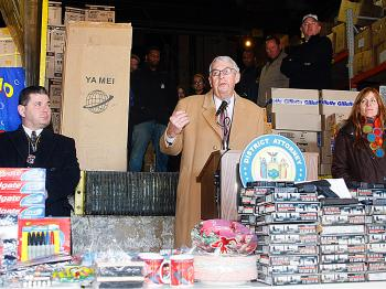 COUNTERFEIT GOODS: King's County DA Charles Hynes, and staff, at a warehouse in Brooklyn where thousands of dollars worth of black market goods were seized, including more than 1,000 realistic fake guns.  (The Epoch Times)