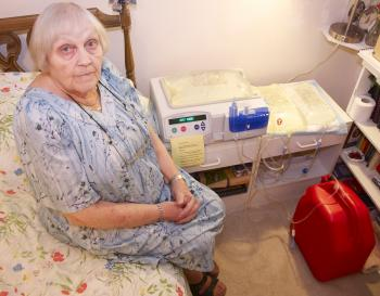 Fanny Goldman sits beside her peritoneal dialysis machine, her companion for nine hours each night ever since diabetes impaired her kidneys to the point they could no longer do their job four months ago. (Matthew Little/The Epoch Times)