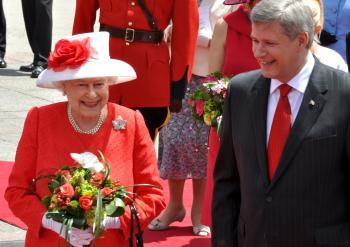 Her Majesty Queen Elizabeth and Prime Minister Stephen Harper arrive at Parliament Hill for the Canada Day celebration (Pam McLennan/Epoch Times)