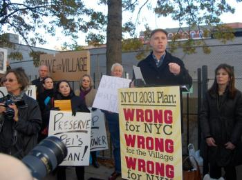 Andrew Berman, executive director of Greenwich Village Society for Historic Preservation, led a rally on Sunday to oppose NYU's plan to build a 40-story hotel and residential tower on Bleeker Street. (Catherine Yang/The Epoch Times)